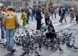 People and pigeons in Piazza del Duomo, Milan's central square