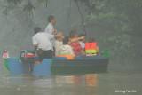 Kinabatangan - Tourist boat in Sukau amid early morning mist.