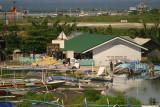 Runway 02 threshold, windsock & Sto. Nino Primary School