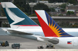 Parked at International Terminal A gate 7 with Cathay Pacific 747  B-HUJ