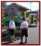 Cooking sausage before procession.jpg