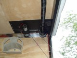 THE 12 VOLT WINCH MOUNTS OVER THE FRAME WORK IN THE REAR AND SIDE AND BOLTS TO THE UNDERSIDE OF THE FORWARD FRAME PIECE