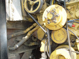 I HAVE THE IDLER PULLEY REMOVED HERE, NOTE THE HEATER HOSE PIPES THAT I PREVIOUSLY MENTIONED
