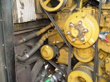 THE IDLER PULLEY IS LOCATED AT THE LEFT SIDE IN THIS PHOTO, THE NEW ONES HAVE A RATCHET HOLE FOR AN ADJUSTING AID