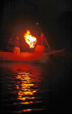 The lights of fire  attract the fish then the Cormorants start their diving and catch