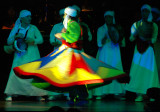 The dancer keeps whirling for an hour accompanied by the drums' beats