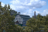 mill peeping thru trees...