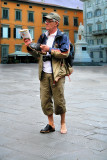 Distinguished gentleman with  one guide book and one shoe...