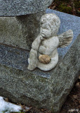 Cherub Entrusted with Visitor's Stone