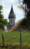 church behind the hill