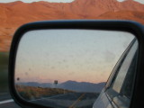 dust in the rearview mirror