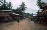 Man Walking Through Village