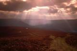 Sun rays bursting through cloud, Monmouthshire