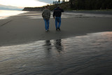 Father and son walking the beach