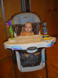 Looking awfully tiny in this highchair!