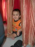 The kid likes curtains!