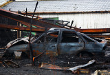 Burnt car in burnt building