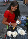 young woman shaving labong (bamboo shoots)