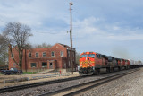 Santa Fe Depot at Chillichothe, Illinois with train lead by BNSF 7703