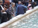 Roma - Money fishing in Trevi fountain
