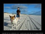 boy dog beach