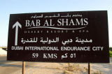 Sign for Bab Al Shams Resort (Gate of the Sun) and Dubai International Endurance City