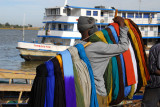 Man selling turbans, Mopti riverfront