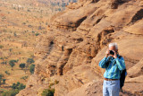 Udo taking a photo from the top of the Dogon escarpment