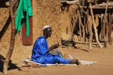 Man wearing silky blue listening to the radio, Ayorou