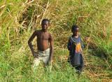 Boys in the tall grass by a stream, Parakou