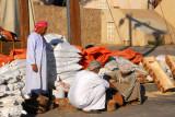 Omani men carving at the Nizwa souq