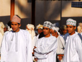 Young Omani men look on at the livestock souq