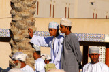 Omani boys looking for a good view of the cattle market