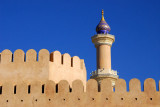 Minaret over the walls to old town Nizwa