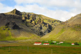 Remote farms wedged between the mountains and the ocean, SE Iceland