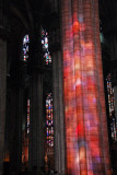 Milan Cathedral - light from the stained glass on a pillar