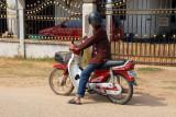 Kuay drove me to Buddha Park on his motorbike