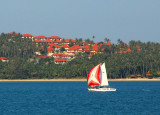 Sail boat passing one of the new real estate developments on Koh Samui