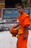 Lao monk with alms bowl