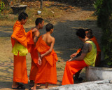 Lao monks talking with a westerner who seems to be a monk as well