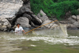 A fisherman with a giant net, Mekong River, Laos