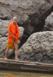 Young monk along the Mekong, Laos