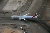 Emirates Boeing 777 under tow, DXB