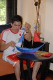 Jeng assembling a boat-shaped kite