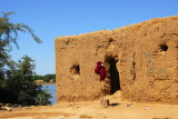 Mudbrick huts along the Bani River at the Djenné ferry landing