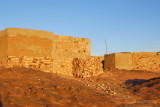 The morning sun illuminates the stone houses in Daga