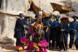 Dogon mask dancer with the older village men who perform the chorus