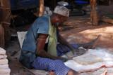 Man cutting a block of salt, Mopti