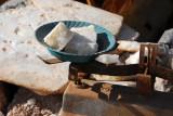 Weighing small blocks of salt, Mopti