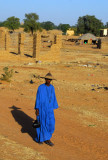 Man in a traditional hat wearing a tuareg blue galabaya